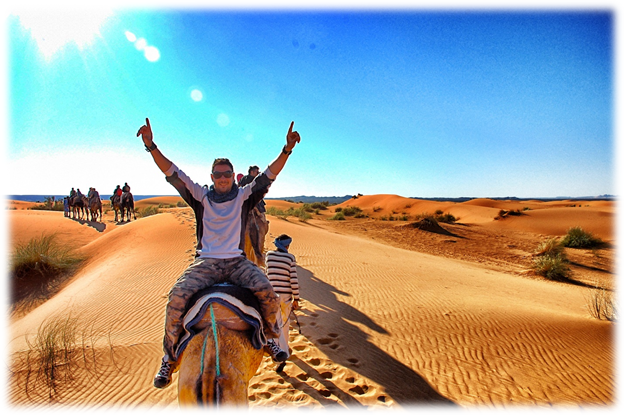Camel trekking and riding in the Sahara Desert