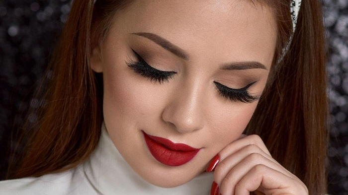 Bold lip color and nude eyes would help you ace the wedding look