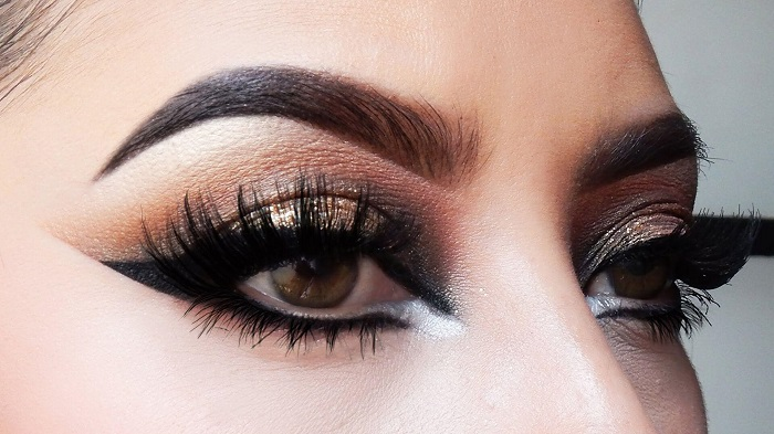Brown smokey eye makeup with a hint of glitter and neutral face